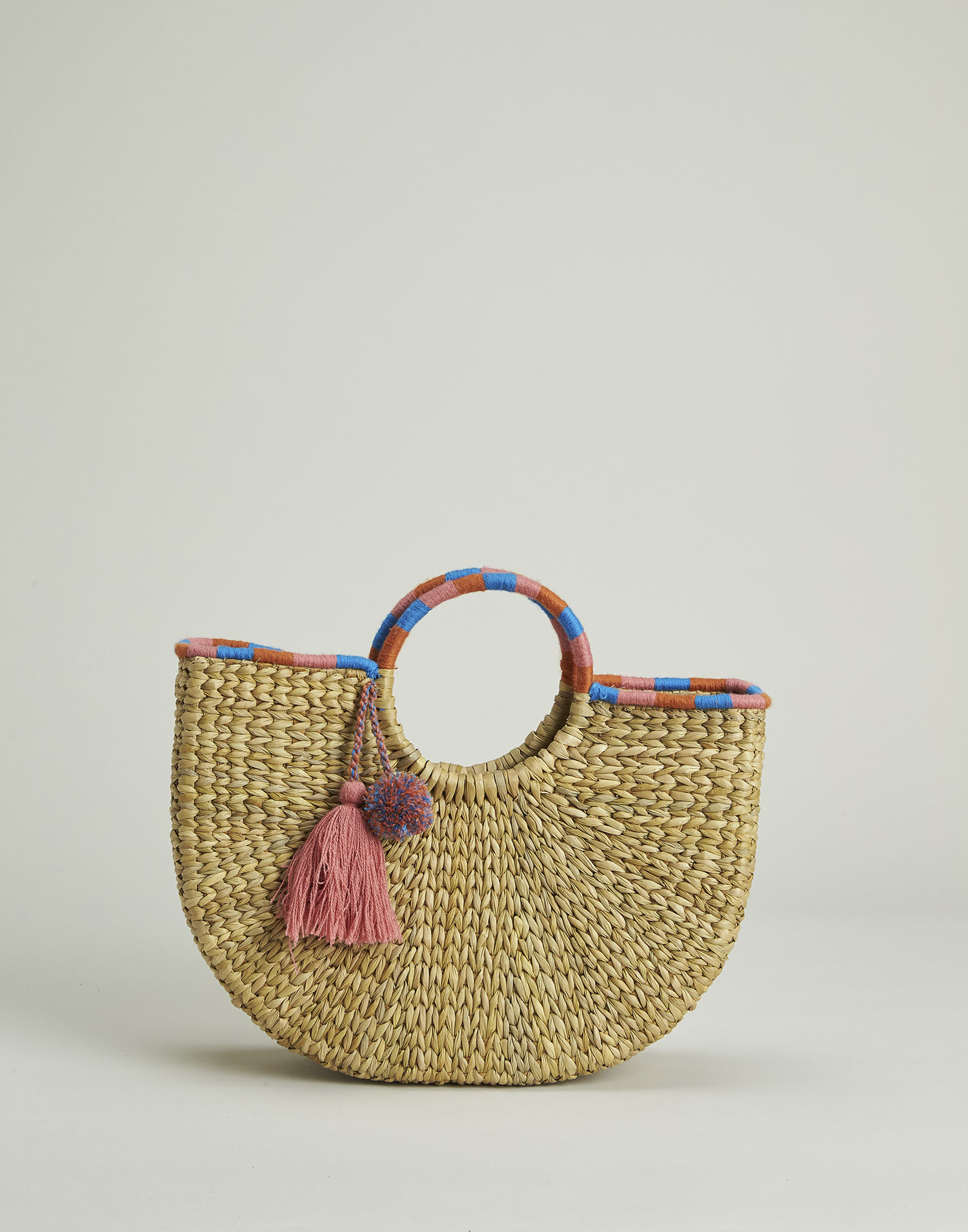 Half moon rigid basket bag