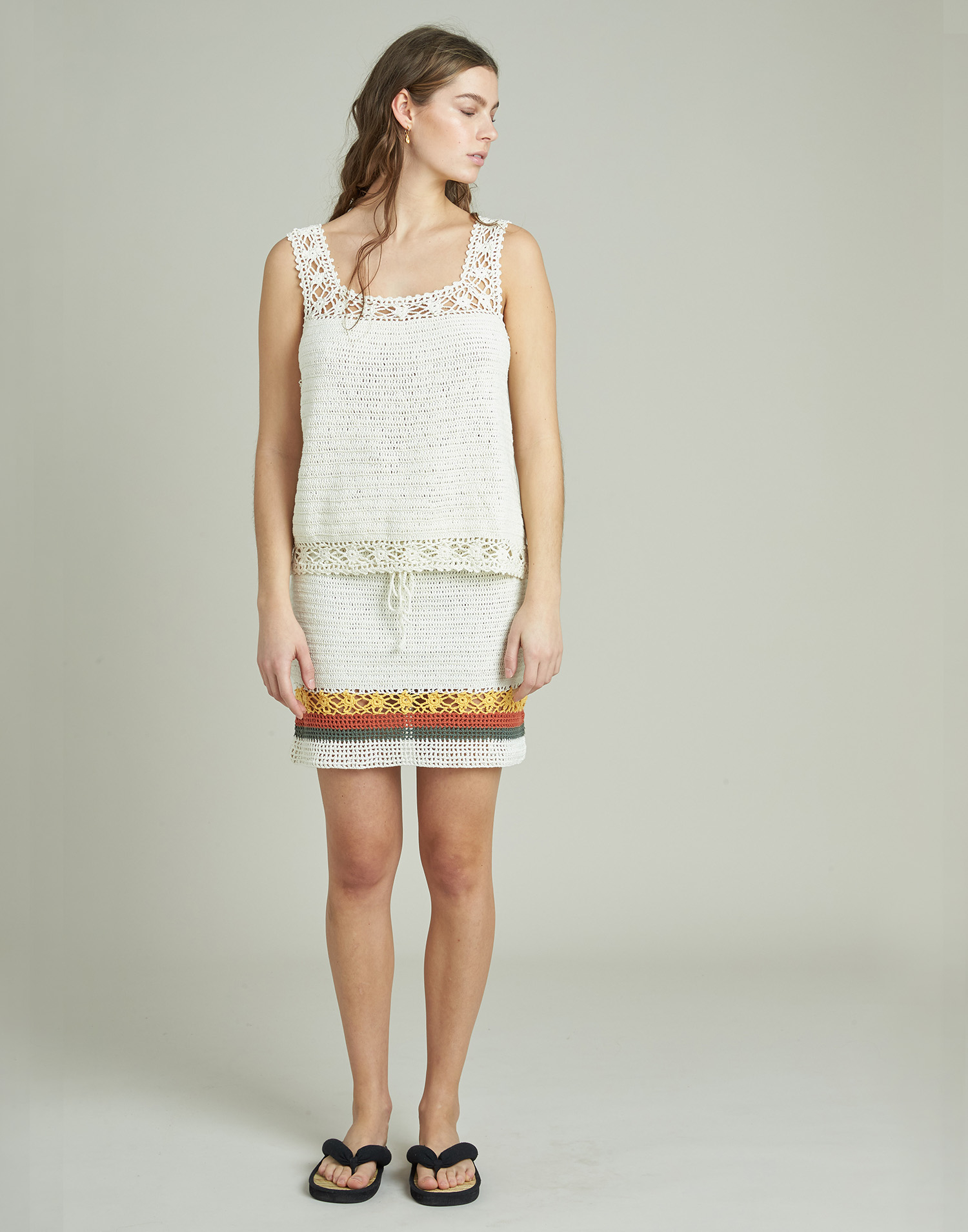 Crochet skirt with positional color stripes
